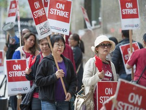 Striking hospitality workers picket the Hyatt Regency hotel in downtown Vancouver on Saturday. Approximately 400 members of Unite Here Local 40 are on strike at the hotel.