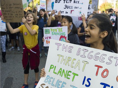 Vancouver, BC: SEPTEMBER 27, 2019 -- Tens of thousands of people concerned about the state of the earth's climate converged on Vancouver city hall Friday, September 27, 2019 as part of a global initiative to bring attention to the environment. The throngs of people marched across the Cambie Street bridge and into downtown.
