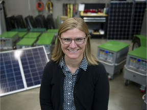 Zena Harris in front of solar panels and battery power stations at Portable Electric at 3095 Hebb Avenue in Vancouver on Wednesday, Oct. 16, 2019. Harris, Creative Director of the Sustainable Production Forum and President of Green Spark Group, is organizing a forum in November that will bring together film industry stakeholders to discuss how to make the industry more sustainable and environmentally friendly.