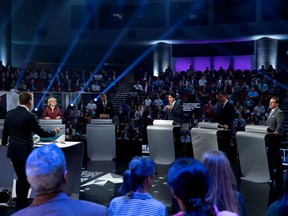 Federal party leaders, left to right, NDP leader Jagmeet Singh, Green Party leader Elizabeth May, People's Party of Canada leader Maxime Bernier, Liberal leader Justin Trudeau, Conservative leader Andrew Scheer, and Bloc Quebecois leader Yves-Francois Blanchet take part in the Federal leaders French language debate in Gatineau, Quebec.