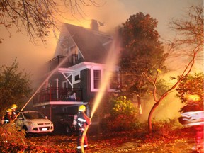 FILE PHOTO - Fireworks were to blame for this fire that destroyed an East Vancouver home on October 30, 2015.