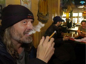 They no longer allow smoking in The Cambie pub, like they did in this 2008 photo, but little else has changed in the landmark Vancouver watering hole.