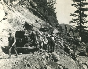 Workers carve out the Hope-Princeton Highway through a rocky cliff, late 1940s. Sun files.
