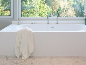 The clean lines of the amanpuri bathtub sets the tone for this bathroom.
