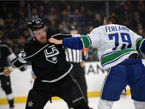 Kyle Clifford fights against Micheal Ferland during the first period at Staples Center.