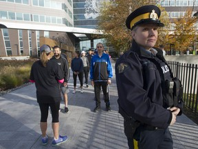 RCMP applicants take part in Run with a Recruiter at E Division Headquarters in Surrey. Pictured is Const. Erika Dirsus, an RCMP recruiter.