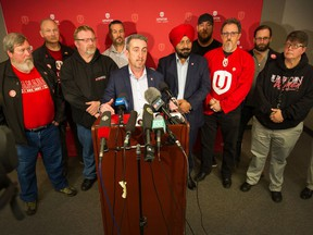 Gavin McGarrigle, western regional director of Unifor, leads a rally at Unifor office in New Westminster, BC, November 20, 2019.