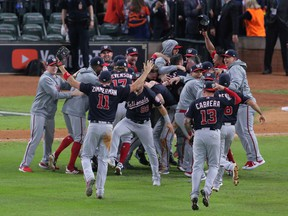 Washington Nationals players celebrate on the field after defeating the Houston Astros in Game 7 of the 2019 World Series at Minute Maid Park on Wednesday, Oct. 30.