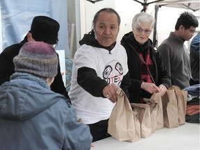 Alex Watts, a formerly homeless man, and his crew of 34 volunteers handed out over 500 packages of urkey sandwiches, mandarin oranges, juice boxes, pastries and hot chocolate on the Downtown Eastside on Wednesday.