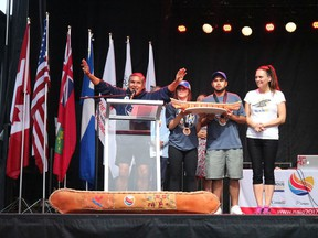 From left, Team B.C. elder Alex Nelson, with flag-bearers Camryn Scully (Métis Nation) and Keegan Charlie (Sts'ailes First Nation) and Team B.C. chef de mission Lara Mussell Savage, at the Toronto 2017 North American Indigenous Games closing (NAIG) ceremony where they accepted the Overall Team Award. Team B.C. will send 520 athletes, coaches and staff to the Halifax 2020 NAIG in July.