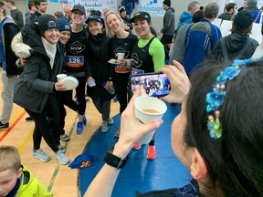 Hamming it up for post-race photos, members of the Mile2Marathon group pose after completing Sunday's Steveston Icebreaker 8K, which attracted a record turnout and blazing fast performances.