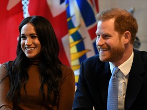 Britain's Prince Harry and his wife Meghan, Duchess of Sussex, at Canada House in London, England.