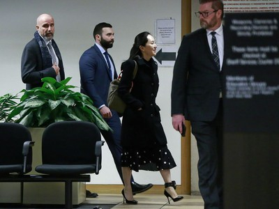 VANCOUVER, BC - JANUARY 20: Huawei Technologies Chief Financial Officer Meng Wanzhou is escorted by her security personnel as she leaves court during a break for lunch on the first day of her extradition trial on January 20, 2020 in Vancouver, Canada. The United States government accused Wanzhou of fraud after HSBC continued trade with Iran while sanctions were in place.