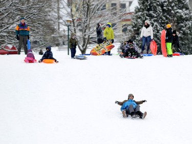 Children enjoy a snow day at Kensington Park as the Lower Mainland is under an extreme weather warning with most schools closed and people advised to stay home if possible in Vancouver, BC., January 15, 2020.