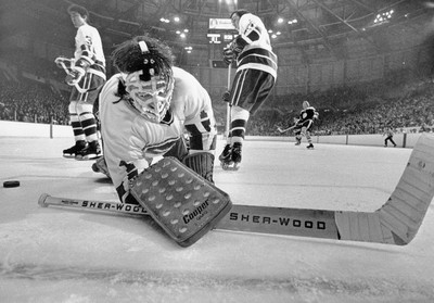 Vancouver Canucks goalie Dunc Wilson's mask is covered in snow after bring sprayed  by Johnny MacKenzie of the Boston Bruins during a game on Dec. 12, 1971. Boston's Fred Stanfield scored on the play.  Ralph Bower/Vancouver Sun