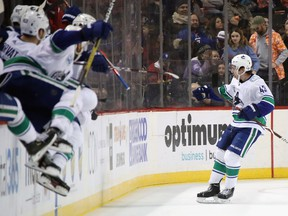 Quinn Hughes #43 of the Vancouver Canucks celebrates his game winning goal in overtime against the New York Islanders at the Barclays Center on February 01, 2020 in the Brooklyn borough of New York City.