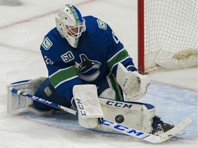 Feb 12, 2020; Vancouver, British Columbia, CAN; Vancouver Canucks goalie Jacob Markstrom (25) makes a save against the Chicago Blackhawks in the third period at Rogers Arena. Vancouver won 3 -0. Mandatory Credit: Bob Frid-USA TODAY Sports