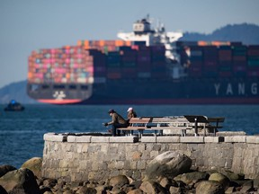A container ship at anchorage is a rare sight in English Bay. Rail blockades across the country have led to an increase in the number of cargo ships waiting to load or unload at the Port of Vancouver.