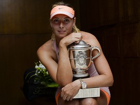Maria Sharapova poses with the Coupe Suzanne Lenglen in her changing room following her victory at the French Open at Roland Garros on June 7, 2014 in Paris. (Sindy Thomas - Pool/Getty Images)