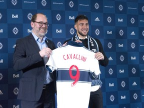 Whitecaps sporting director Axel Schuster welcomes the MLS team's newest signing, Canadian striker Lucas Cavallini, to Vancouver during a news conference on Dec. 16, 2019, at B.C. Place Stadium.