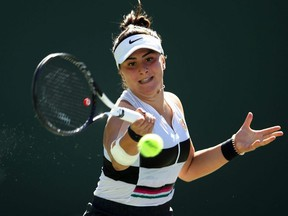Bianca Andreescu, seen here in final round action at the 2019 Indian Wells tournament, will not defend her title later this month due to a knee injury.