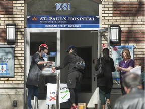 Vancouver, BC: MARCH 20, 2020 -- Visitors to St. Paul's Hospital in Vancouver, BC are screened before they enter the hospital Friday, March 20, 2020.