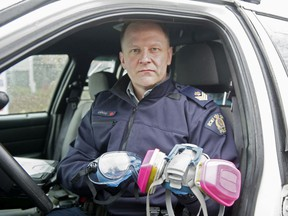 Sgt. Dave Edge of the Richmond RCMP holds a mask and goggles Mounties are wearing to calls during the COVID-19 crisis.
