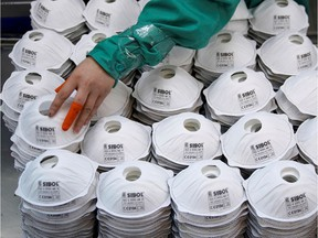 Masks are seen on a production line manufacturing masks at a factory in Shanghai, China on Jan. 31, 2020.