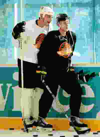 Sep. 12, 1996 -- Buddies Gino Odjick and Pavel Bure chat during Thursday morning Canuck training session in Whistler. Province photo by Bonny Makarewicz.