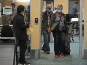 Cynthia and Vartan Temorcioglu of Chilliwack arrive on a flight from Dallas Friday. They were returning from a Mexican vacation. Extra precautions are being taken at Vancouver International Airport because of the novel coronavirus pandemic.