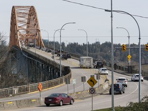 Traffic moves with no delays over the Pattullo Bridge at mid-afternoon on Monday.