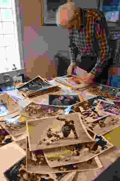 Former Vancouver Sun photographer Ralph Bower going through old prints of Vancouver Canucks games he photographed, Jan. 21, 2020. John Mackie/PNG