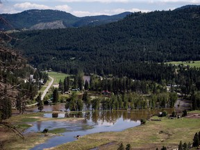 CP-Web. Flooded land is seen after the Kettle River overflowed its banks in Rock Creek, B.C., on Sunday May 13, 2018. The neighbouring Regional District of Central Kootenay issued an evacuation alert for all of its communities except for the cities of Castlegar and Nelson late Saturday evening.