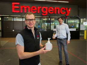 Chris Nelson, right, the owner of Pacific Sands Beach Resort in Tofino and an investor in the Shelter Point Distillery on Vancouver Island, delivers 2000 litres of hand sanitizer to VGH anesthesiologist Dr. Neil Ramsay on Sunday.