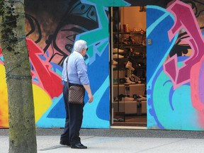 A boarded-up store on Vancouver's Robson Street on May 11 as worried businesses wonder about paying those pre-COVID rents in a different 'new normal' during the pandemic.