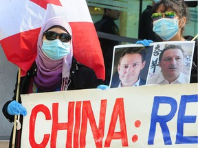 Perhaps most immediately at risk following Wednesday's court ruling are the two detained Canadians in China, Michael Kovrig and Michael Spavor, pictured on a sign carried by protesters outside court.