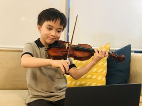 Karen Gerbrecht's student Christopher playing for the camera.