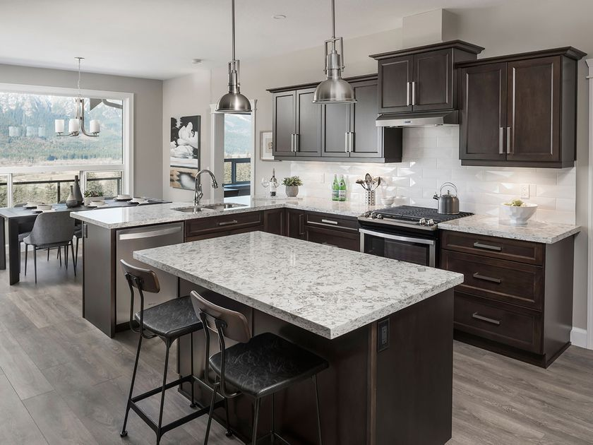 The kitchen is based on a functional triangle layout, and features a handy island, Whirlpool appliances and a walk-in pantry.