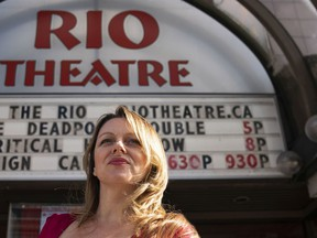 Rio Theatre owner and operator Corinne Lea poses for a photo outside prior to the start of the double bill of Deadpool and Deadpool 2 for a fundraiser to help save the theatre in Vancouver.