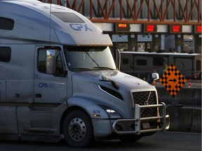 A truck waits in line to U.S. customs to enter into Blaine, Washington, at the truck route border crossing, after additional measures to combat the spread of novel coronavirus disease (COVID-19) were announced, in Surrey, Canada March 18, 2020.