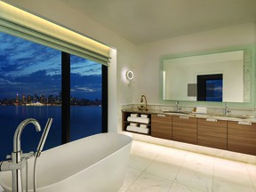 Guests can soak in the view of the city skyline at night from the huge soaker tub.