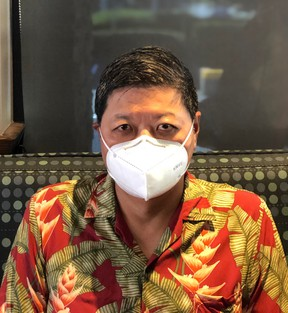 Vernon Lau, general manager of Alais Ventures in Richmond, B.C., displays the company's KN95 mask.