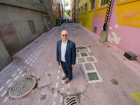 Charles Gauthier, CEO of the Downtown Vancouver Business Improvement Association, stands in the brightly coloured Alley Oop of which he's proud on Wednesday.