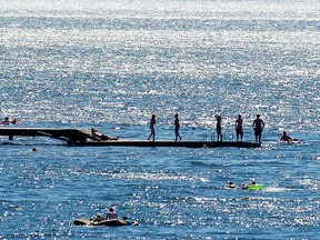 Swimmers at Entrance Bay Beach in Cultus Lake in a file photo. RCMP are warning about busy waterways after a boat crash on the lake on July 29.