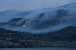 Flames and smoke are seen from the Christie Mountain wildfire along Skaha Lake near Penticton on Thursday.