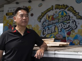 Raymond Cheung, owner of the Richmond Night Market, poses on the main stage inside the market. Work had just begun rebuilding the stage from last year's theme, Chill Party, to this year's 20th anniversary theme when worked halted because of the pandemic.