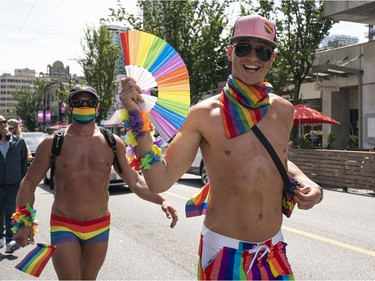 Members of Clean Sober Proud march along Davie Street to celebrate gay pride in Vancouver, BC, August, 2, 2020.
