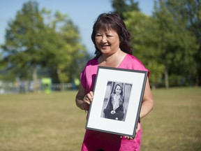 Carol Todd holds a photo of her daughter Amanda Todd, the 15-year-old who committed suicide in October 2012 after being bullied online.