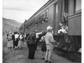 """Japanese-Canadians leaving the Vancouver area after being prohibited by law from entering a """"protected area"""" within 100 miles of the coast in B.C."""