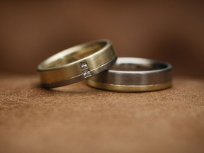 Golden wedding rings. Getty Images/iStockphoto [PNG Merlin Archive]